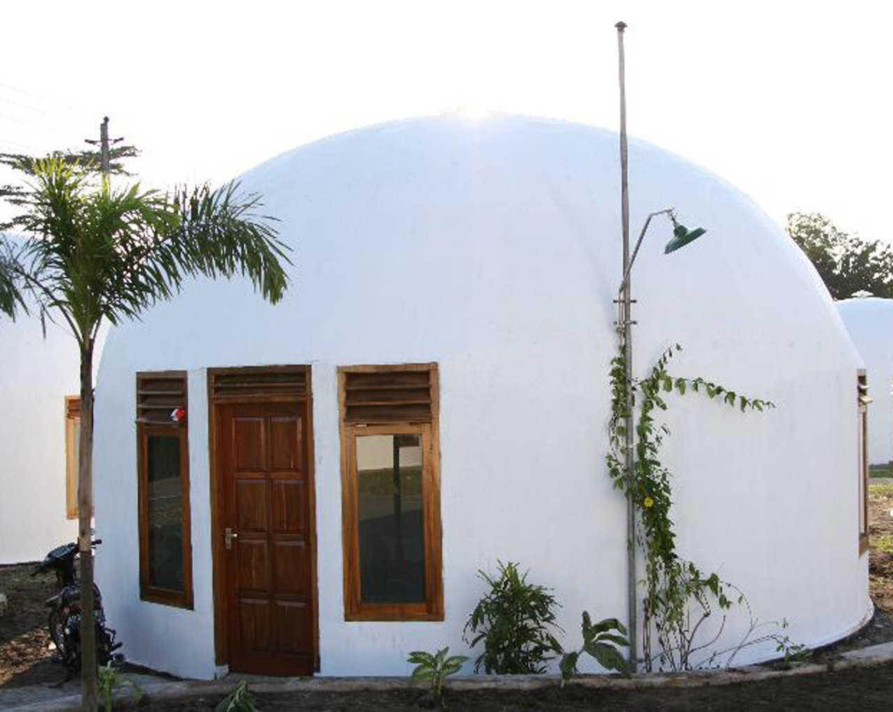 Monolithic EcoShell in Indonesia — Domes For The World trained native workers to build Monolithic EcoShell Domes which provide clean, low-energy use, fire- and disaster-resistant homes and public buildings in New Ngelepen, Indonesia.