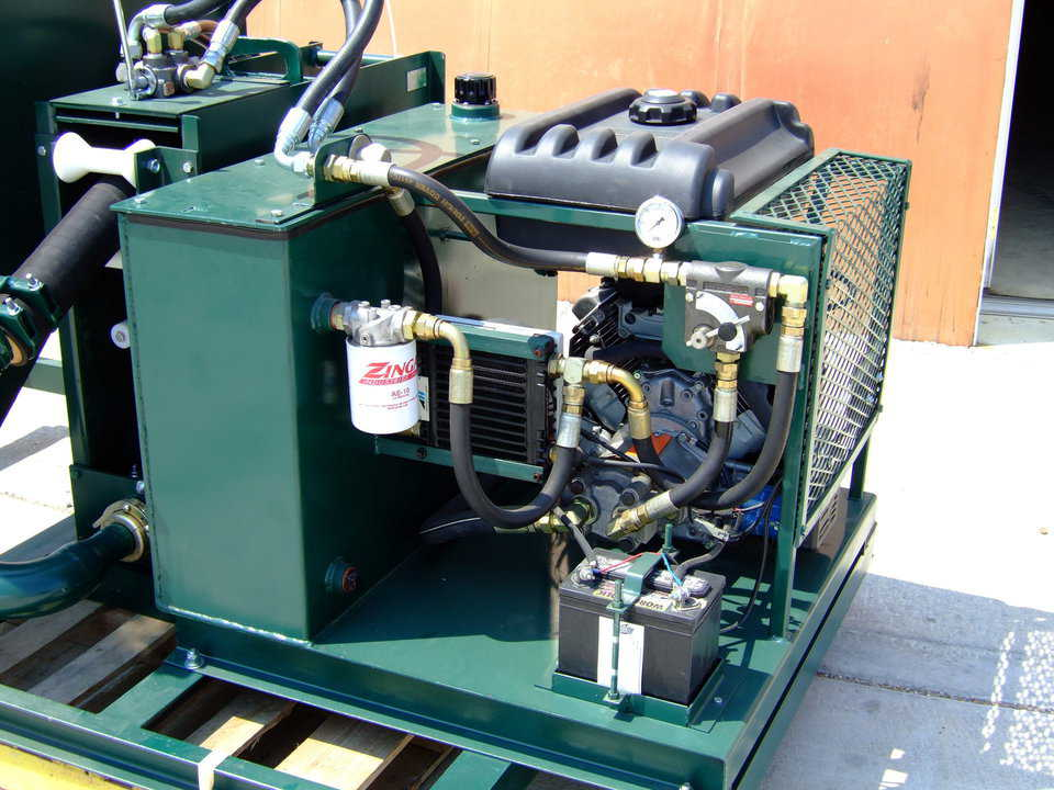 Power Unit — This 20 HP power pack is driven by a Honda motor and features a hydraulic cooling unit, variable flow control, electric start, and a 5 gallon fuel tank.