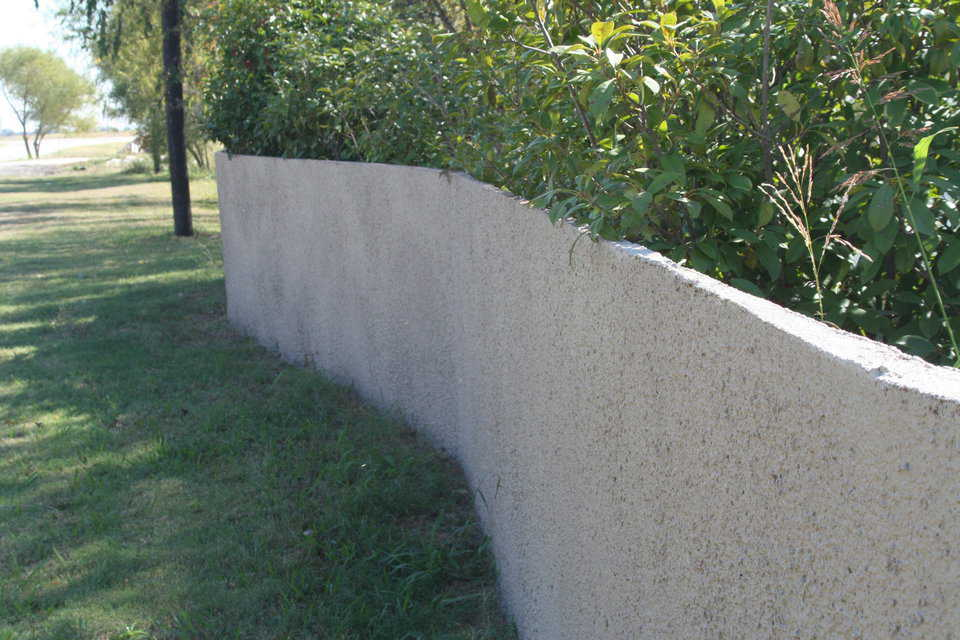 Spray-in-place security — Fence with washed aggregate surface