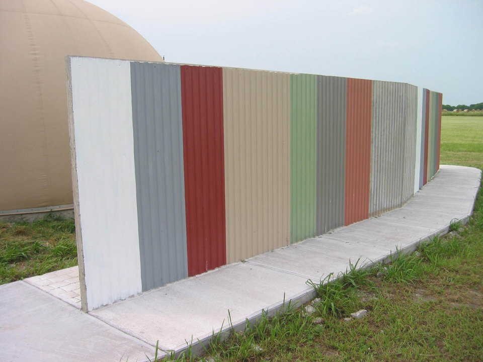 Corrugated steel appearance — The texture on this fence was achieved by using corrugated steel as the form.