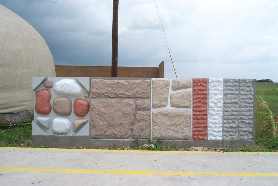 Finish Displays — River rock (left), two types of field stone (center), rock face brick (right). The sprayed-in-place rock was stained. Shown is a pentrating stain. An acid stain or paint could also be applied. These fences are stronger and less expensive to build than a conventional rock fence.