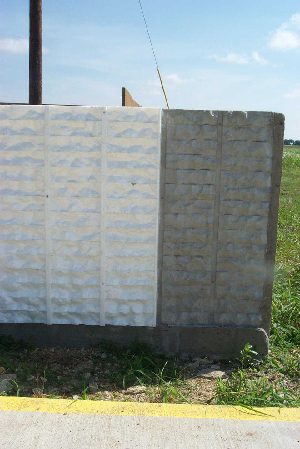 Colored concrete — The form liner for the split face brick is a negative of the finished fence. It is easily removed from the cured concrete and can be used over again – generally 10 times. Colored concrete can be used to provide a base color to the fence