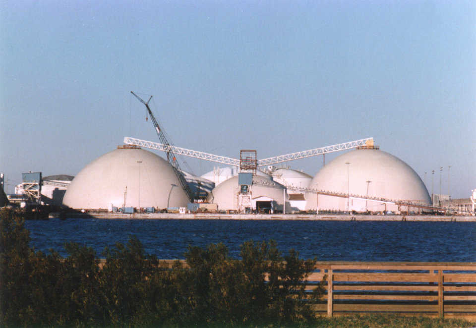 Fertilizer Storages — The PCS Phosphate complex in Morehead City, North Carolina includes two 172′ × 85′ and one 132′ × 51′ domes. In 1996 Hurricane Bertha ravaged Morehead City, but did not succeed in damaging the Monolithic Domes.