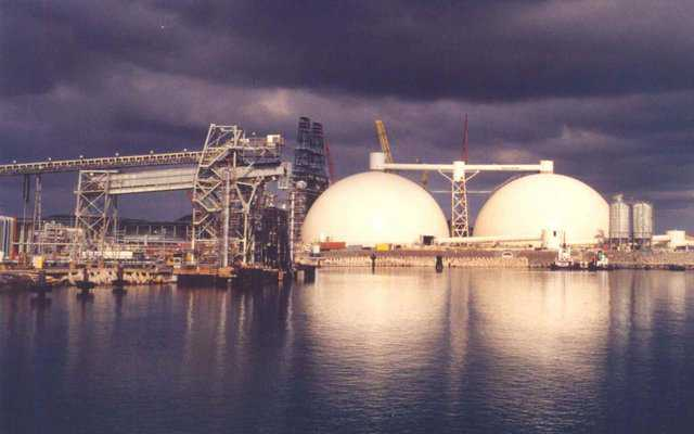 Petroleum Coke Storage — In St. Croix, US Virgin Islands, Hovensa Coker Storage, Bechtel Corp. has two 254′ × 127′ Monolithic Domes. With a capacity of 40,000 metric tons, they're the world's largest petroleum coke storages.  After this photo was taken, an equipment tower and conveyor system was set on top of the domes. The weight allowance was one million pounds.