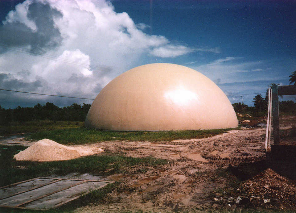 Food Storage — A 50' diameter Monolithic Dome is used for storing dry pack food in Ambergris Caye, Belize. From Friday, Sept. 29 to Sunday, Oct 1, 2000 Keith, a Force 4 hurricane with winds up to 135 mph, raged over Ambergris Caye. Keith uprooted trees, flattened buildings, overturned aircraft and jettisoned boats onto rocks, but the dome survived beautifully.