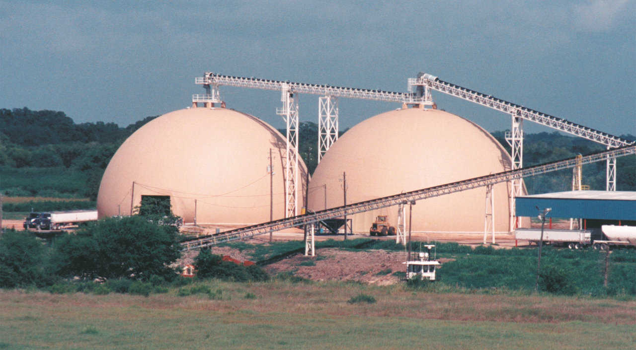 Ammonium Nitrate and Diammonium Phosphate storage — Equalizer Inc.'s twin Monolithic Domes, 130' x 70' each, at the Port of Victoria in Victoria, Texas