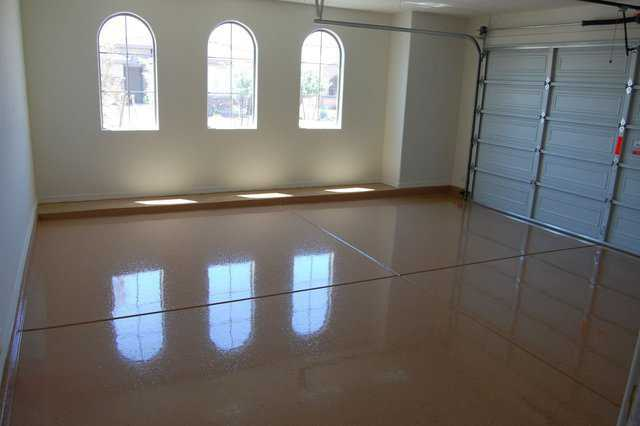 Garage floor — A properly installed epoxy floor can beautify a garage and enhance the value of a house.