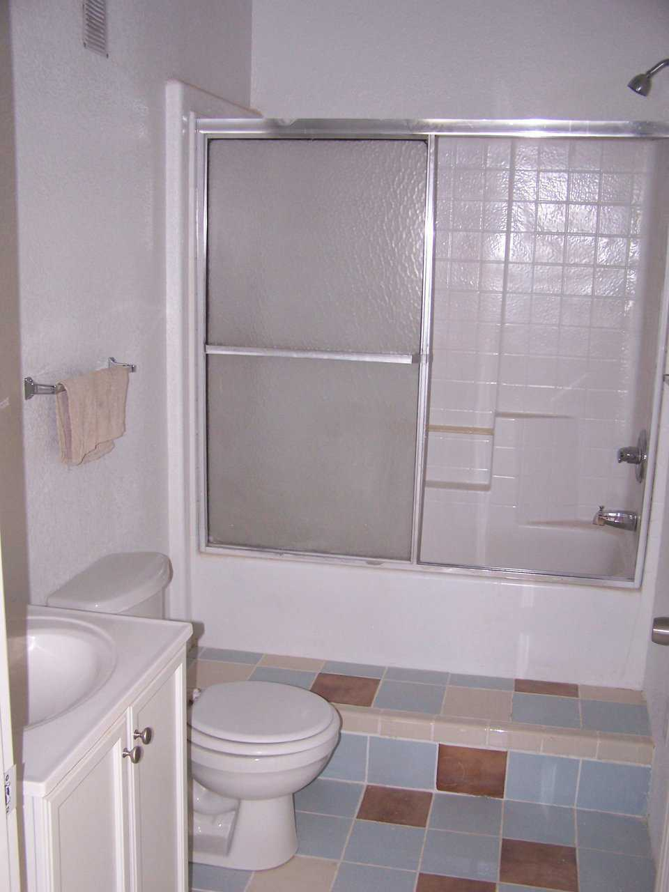 Guest bathroom — It includes a tub with an enclosed shower.