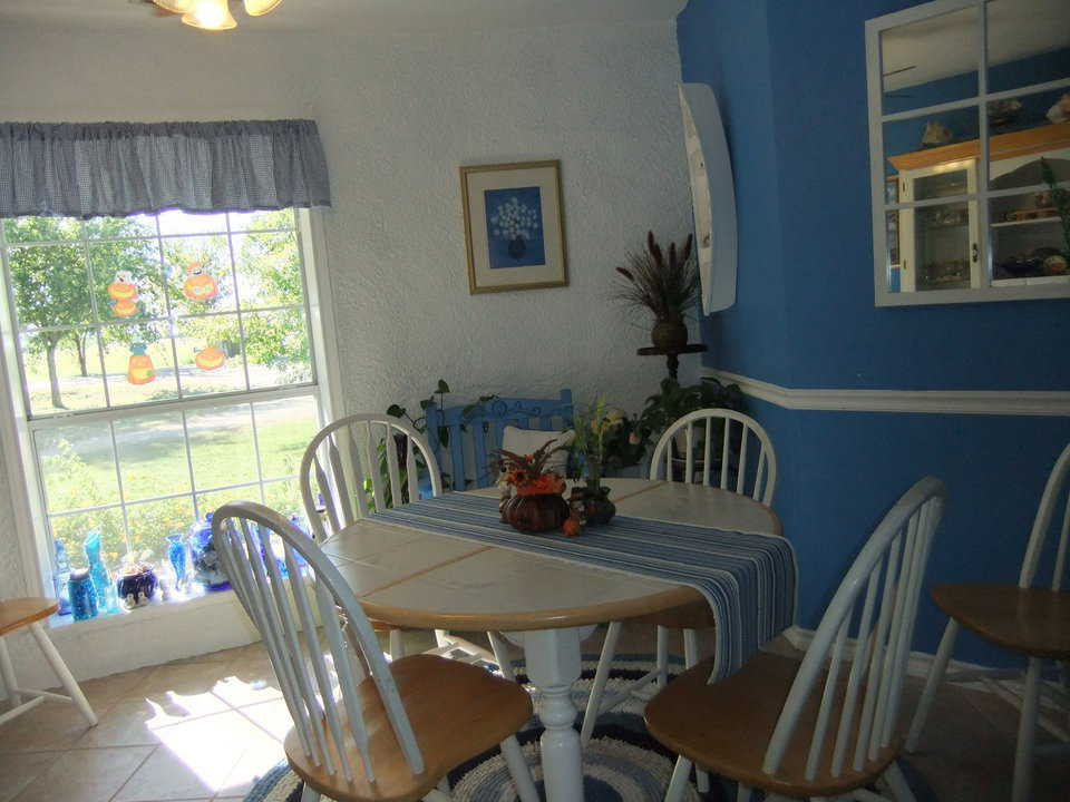Family Dining Area — One wall sports a large window so sunshine pours through while another is painted a happy blue.