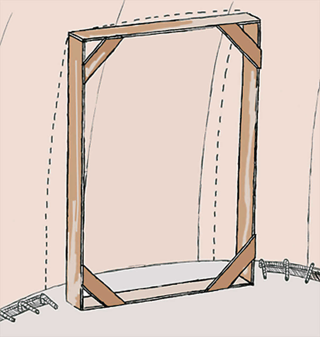 Figure 9 — Another way of making an inset opening is to make a frame to fit the opening. Using the measurements you have marked on the Airform, cut wood pieces to size of opening. Standing the frame up to the dome, check for level accuracy.