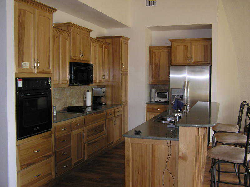Finished Kitchen — Custom made, hickory cabinets provide beauty as well as storage.