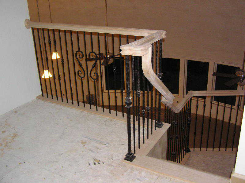 Decorative balusters — A forward S and a backward S enhance the wrought iron balusters.