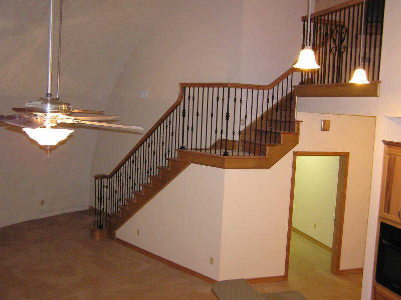 Heading up! — This lovely stairway leads to the loft. Its banister and stair treads are made of red oak.