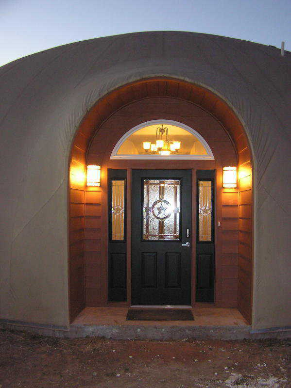 Welcoming entrance — A Texas Star dominates the decorative, cut-glass inserts in this ornate front door. Soft lighting adds a glowing warmth and welcome.