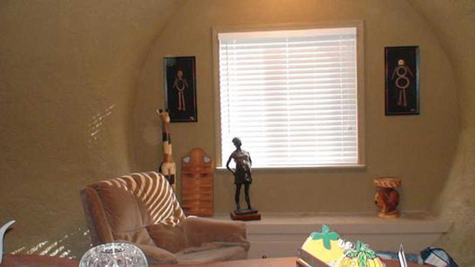 Living room — It's cozy, well lit and decorated with Jamaican art.