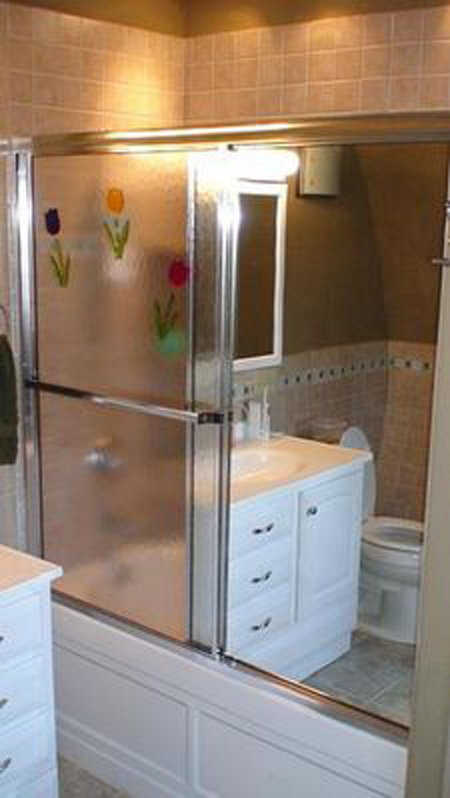 Bathroom — It features an easy-to-care-for tile shower, counter top and floor.