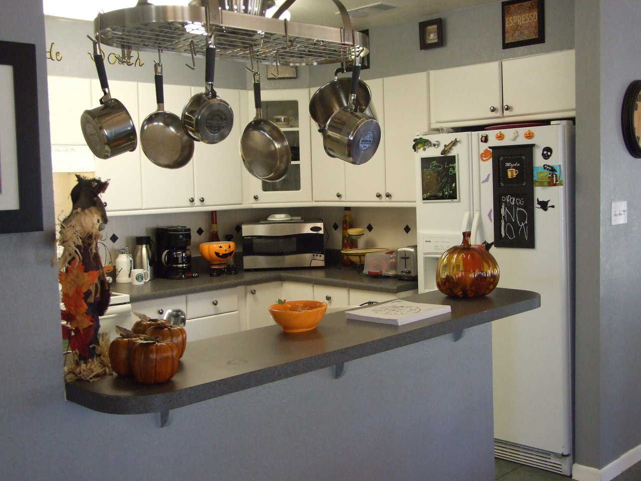 Kitchen — Easy-to-reach preparation areas and hanging cookware make this kitchen an easy and enjoyable workplace.