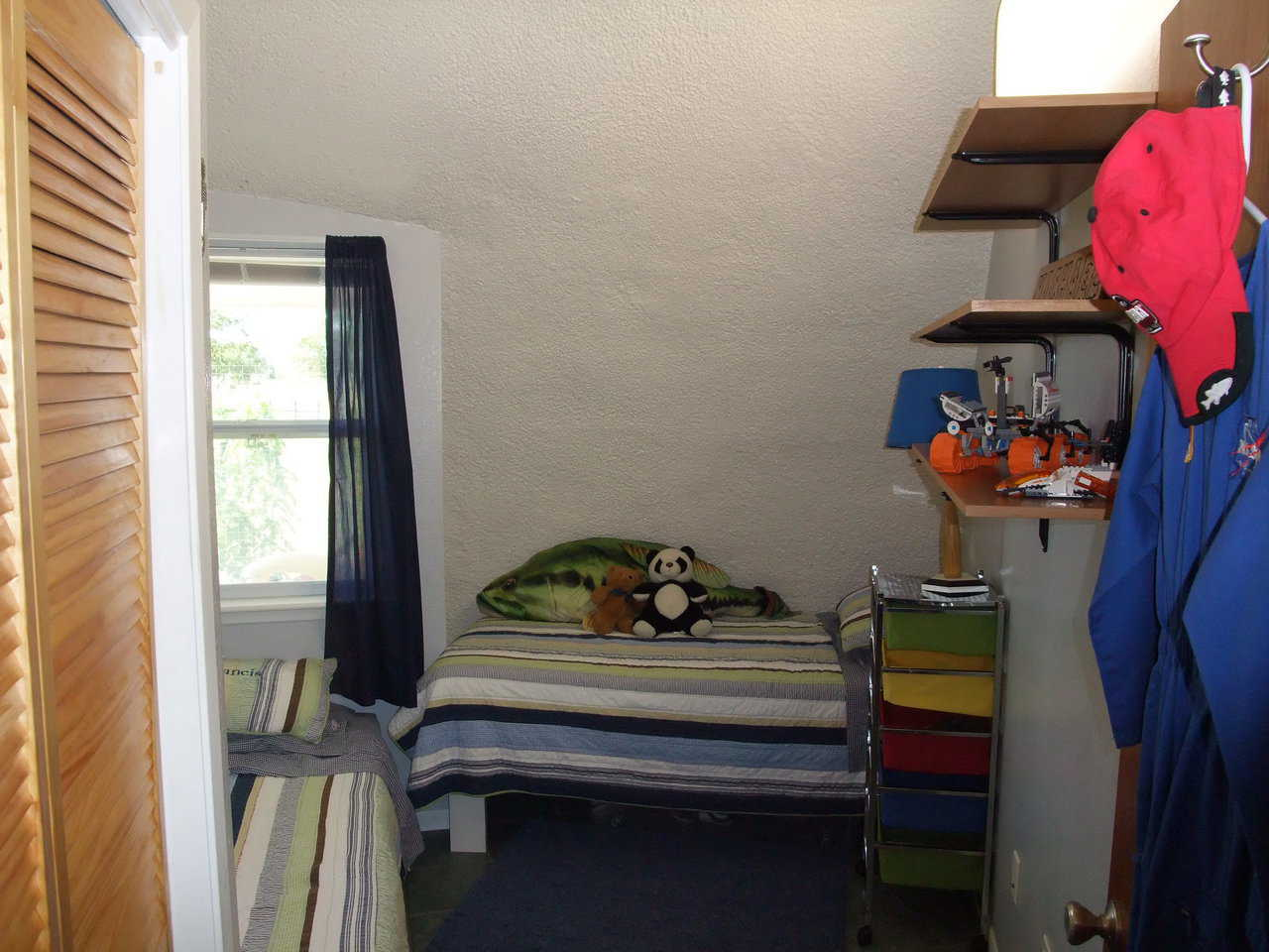 Boys' bedroom — It includes beds and shelves for toys, tools and books.