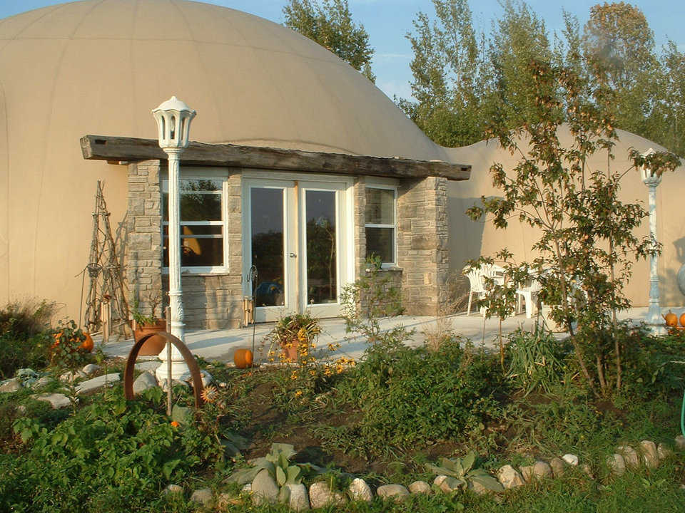 Monolithic Dome Dream Home — Rebecca and Sunny Cushnie of Southampton Ontario, Canada enjoy these two interconnected domes. The larger dome includes the main living/dining area, a kitchen, laundry room and two bedrooms. The smaller come encompasses the master suite.