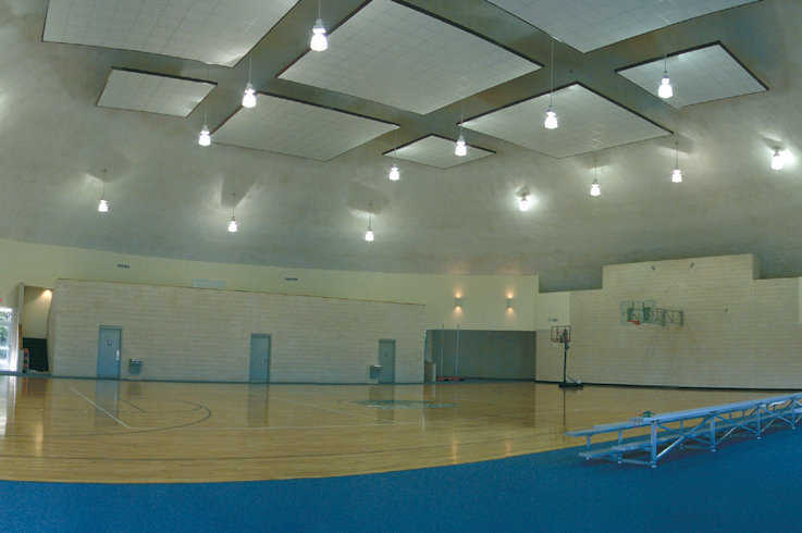 Thousand Oaks Gymnasium near Barry, Texas. — The hanging acoustic panels combat the noise in the gymnasium.