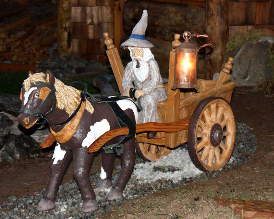 Gandolf in His Wagon — This beautifully designed piece is made entirely of cement and was handcrafted specifically for Hobbit House of Montana.