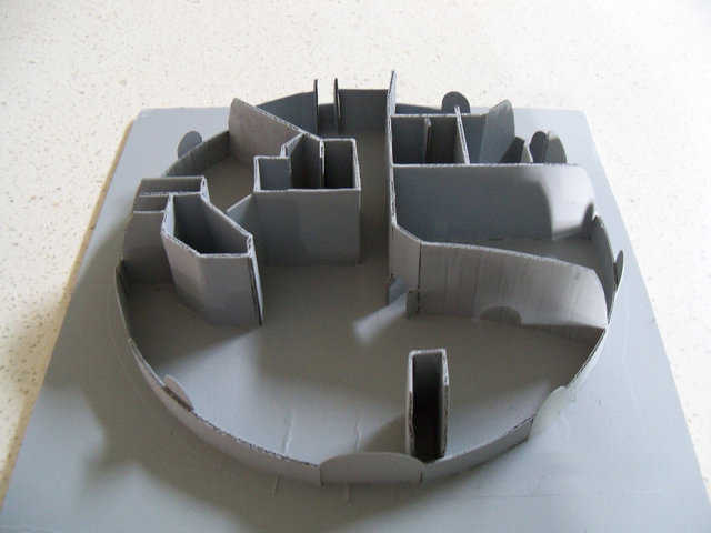 3-D Model — After brainstorming their floorplan, the Ecker's built this cardboard 3-D model to study how light and room area might appear in their finished Monolithic dome.