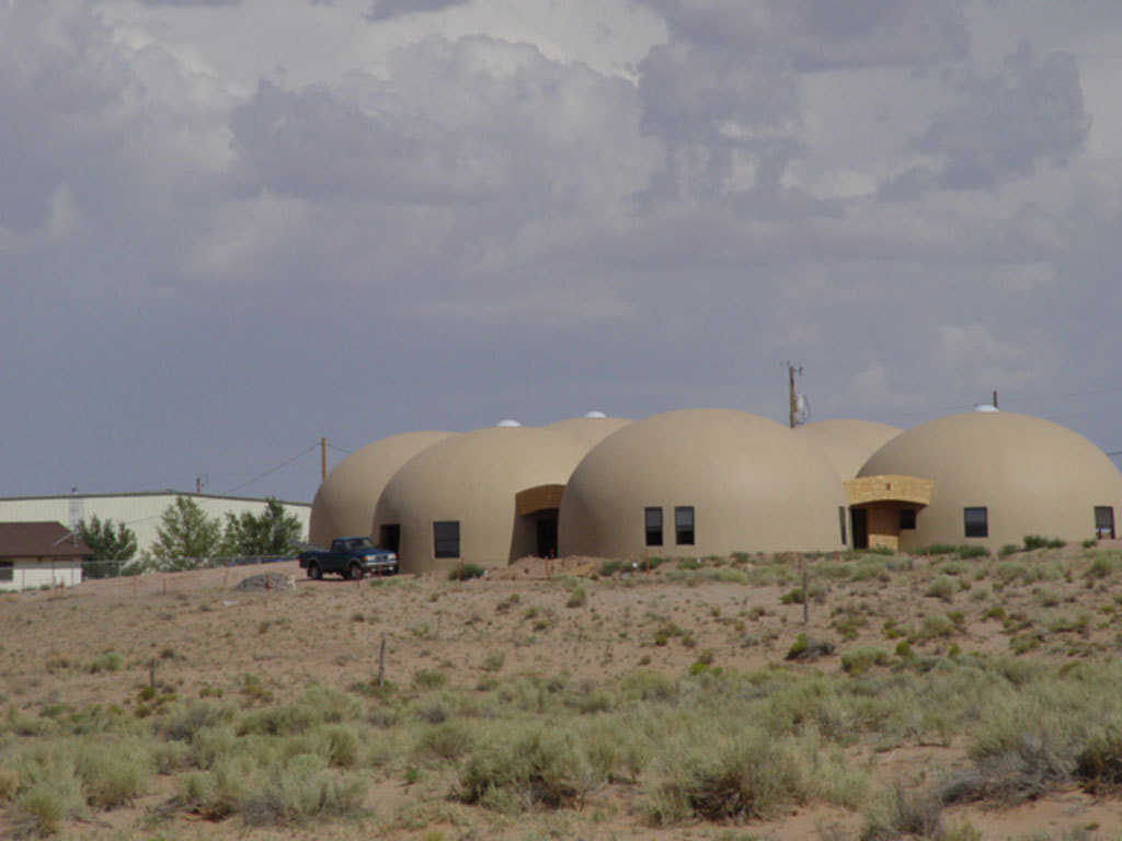 Rentals — These 32-foot-diameter Monolithic Domes are residential rentals built for Tolchii' Kooh teachers and citizens at Taloni Lake, Arizona.