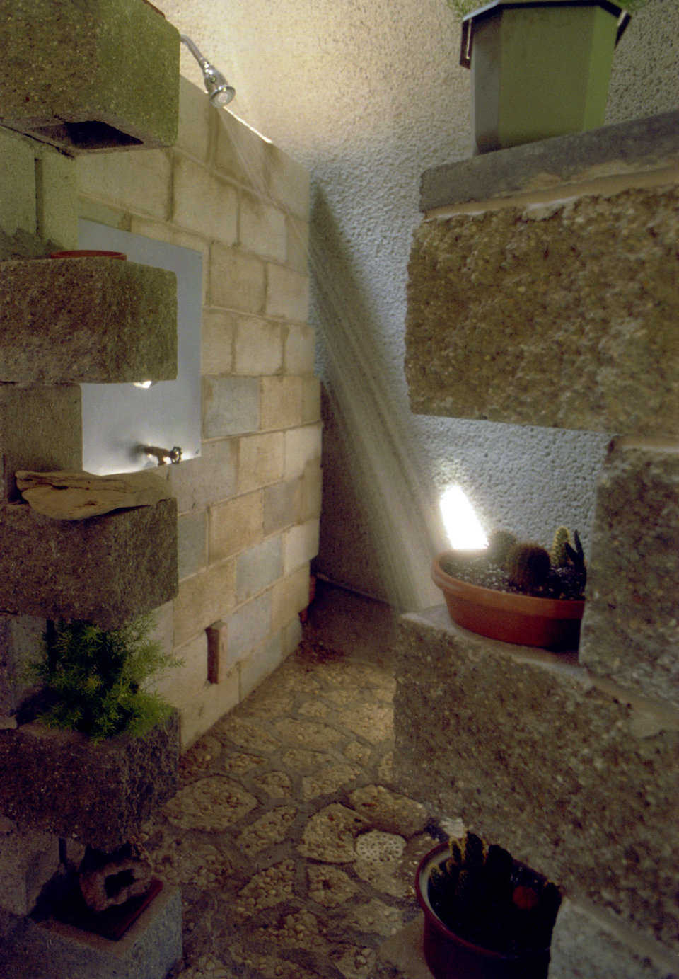 Luxurious bath — The custom shower uses the dome wall, natural rock and concrete block.