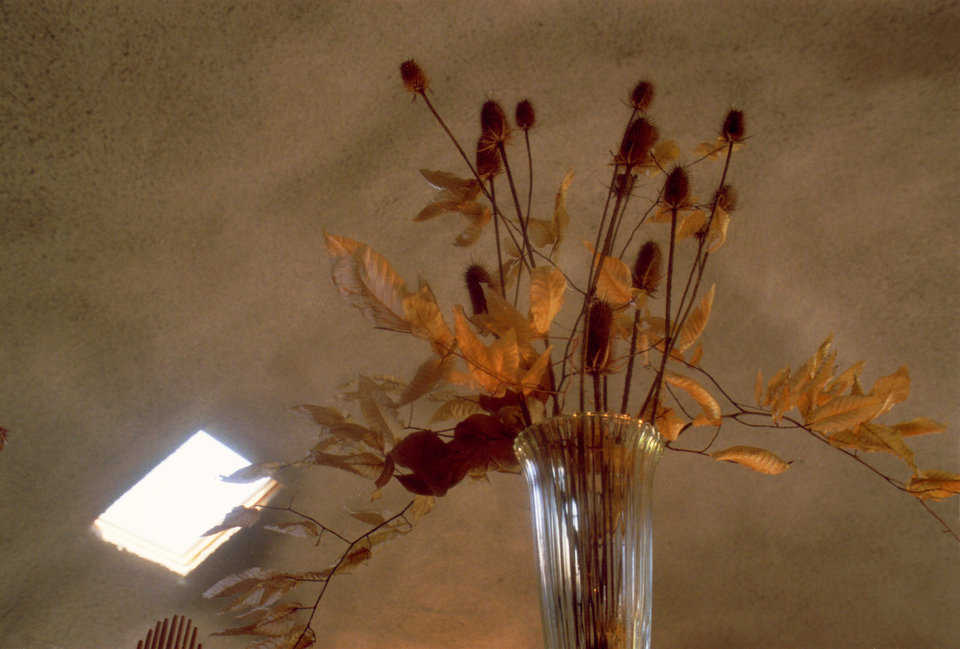 Bouquet of dried flowers — It complements the rough, shotcrete textured surface on the dome's interior.