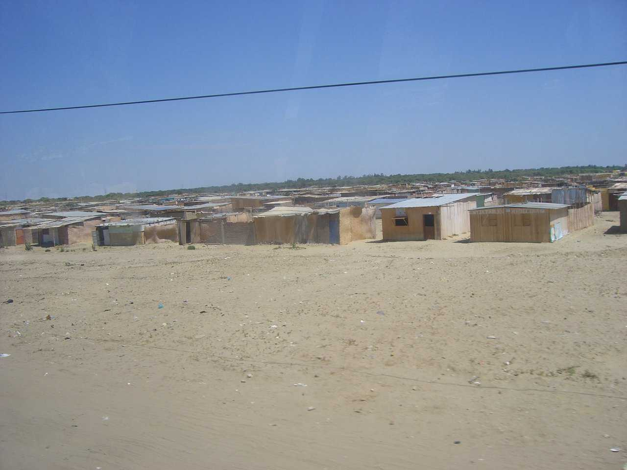 Current Housing near Piura — Currently areas like this are the only hope for many low-income workers.  This area stretched for nearly 8 miles.  Most of these are little more than straw mats with dirt floors, and little or no protection from rain and sun.
