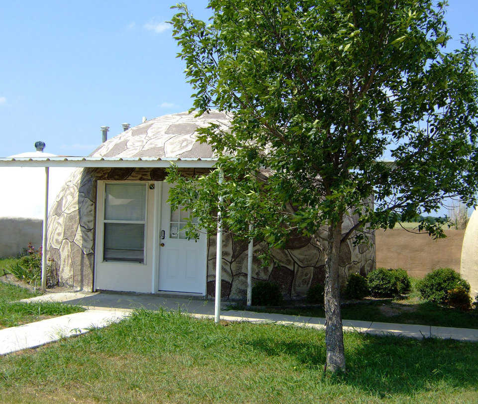 IO-24 — This IO-24 is located on the Monolithic Dome Institute's property in Italy, Texas.  It is a 450 square foot rental unit.  The concrete coating on the outside of this dome was stained using  a siliconized concrete stain.