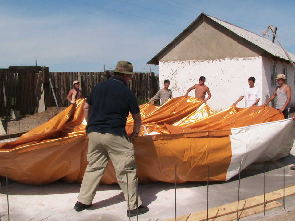Spreading — A crew readies the Airform for inflation by spreading it out.