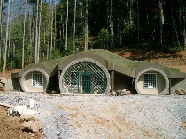 A Monolithic Dome Hobbit Home — The front entrance of this earth-bermed, Monolithic Dome home was designed to look like the entrance to a hobbit hole.