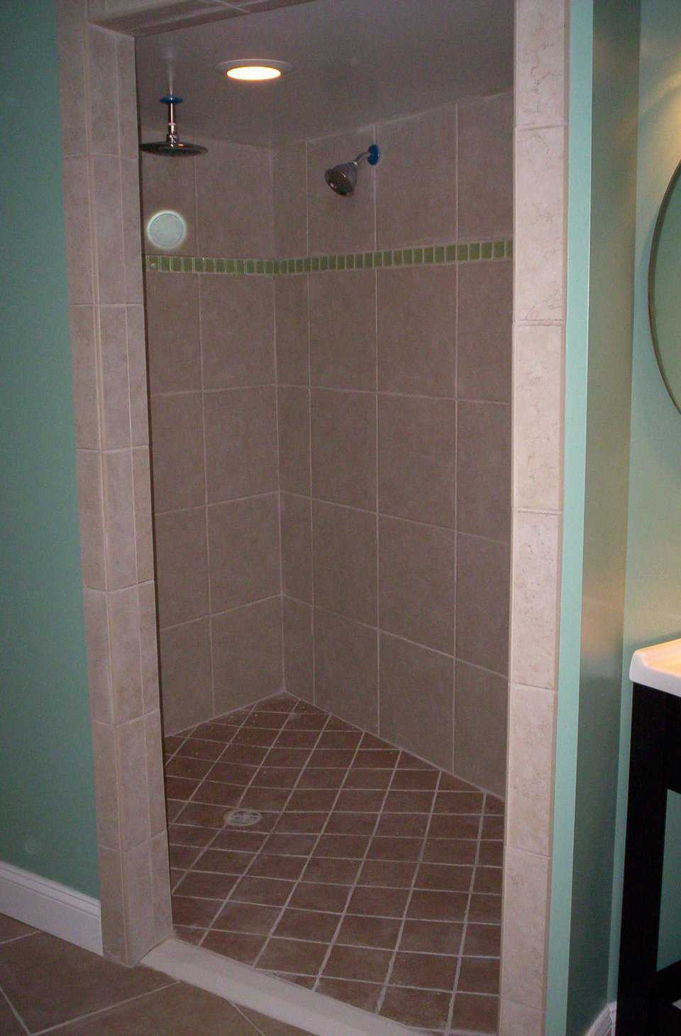 Roomy and Easily Maintained — Walk-in shower sports tile in bold, contrasting colors and space for a shower chair.