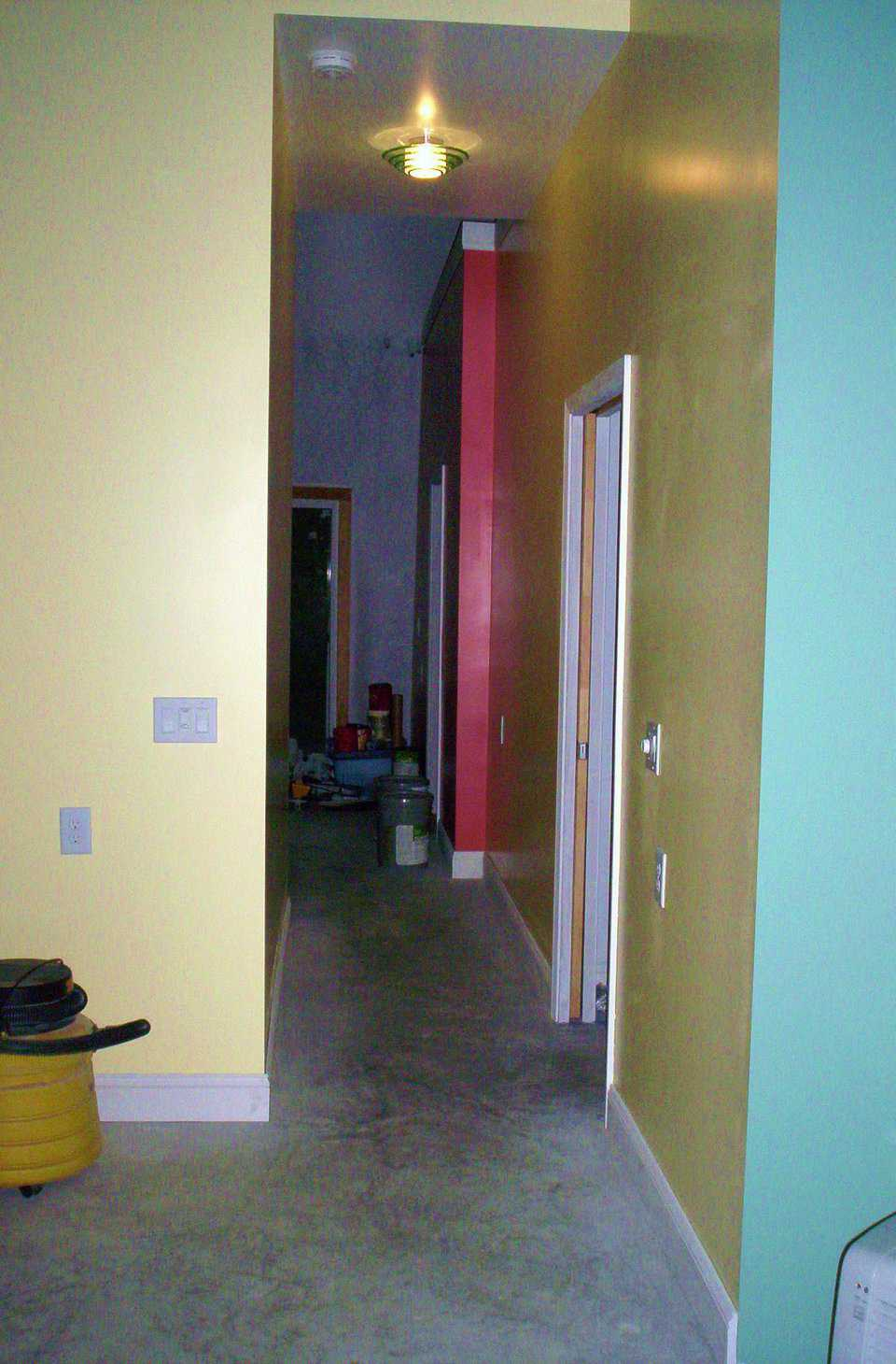 "Wide Hallway — Bold colors break up spaces and identify corners and outcroppings.  A 36"" wide hallway allows safe passage for persons with a cane, walker or wheelchair. (Ceilings are 9' tall, which makes the hall width appear less than 36"".)"