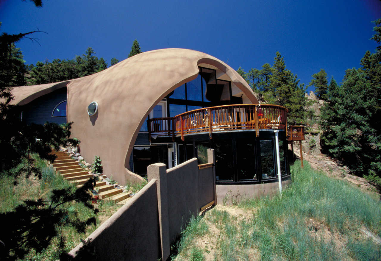 Garlock Home in the Colorado Rockies — It consists of 2 domes merged into a unique, kidney shape: a 32' diameter garage gently blends into the larger, 50' diameter shell placed 9' below it. Home has 3 levels and 3800 square feet of living space.