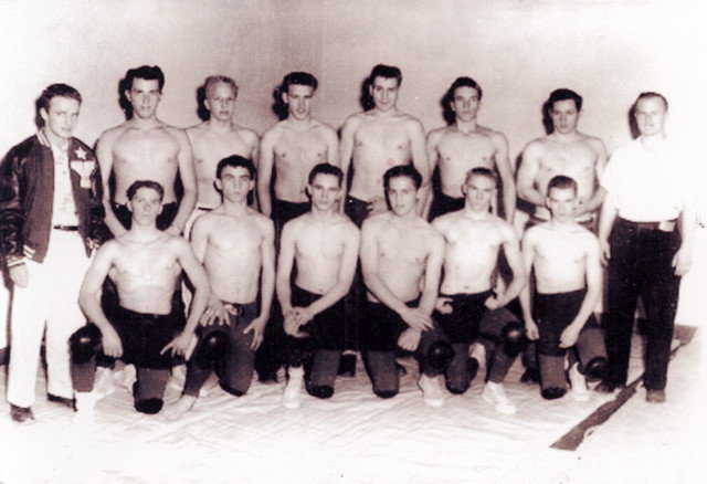 Coach Wilson — Arnold, as a volunteer coach, started the Springville High School Wrestling Team (1955).