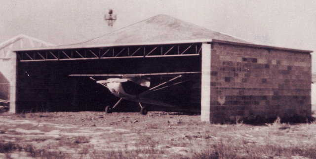 Arnold became a pilot in 1954.  — Hyperbolic paraboloid concrete roof for the airplane hangar of Arnold's father at Spanish Fork, Utah.