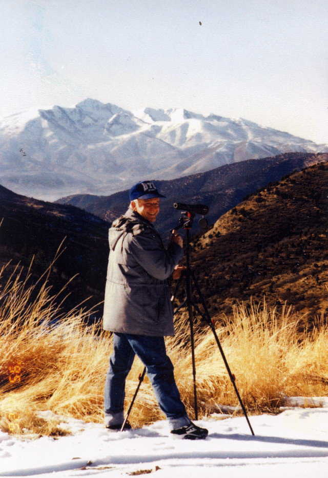 Outdoorsman — Using a spotting scope, Arnold enjoys the wildlife of the local mountains.