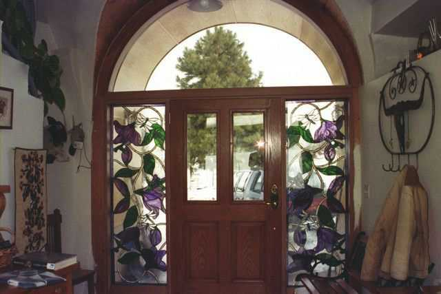 Beautiful sidelights — The design is hummingbirds, dragon flies, and flowers on vines.