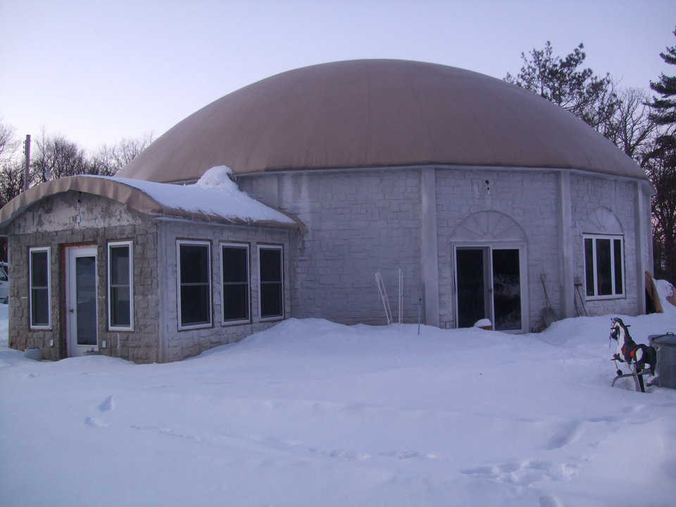 An Orion in Winter — The Pembers decided on an Orion, a Monolithic Dome style fashioned with straight walls or panels joined into a circle and topped by a dome.
