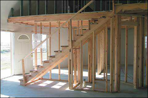 Under Construction — Second floor and staircase during construction stage in the home of Gary Clark in Italy, Texas.