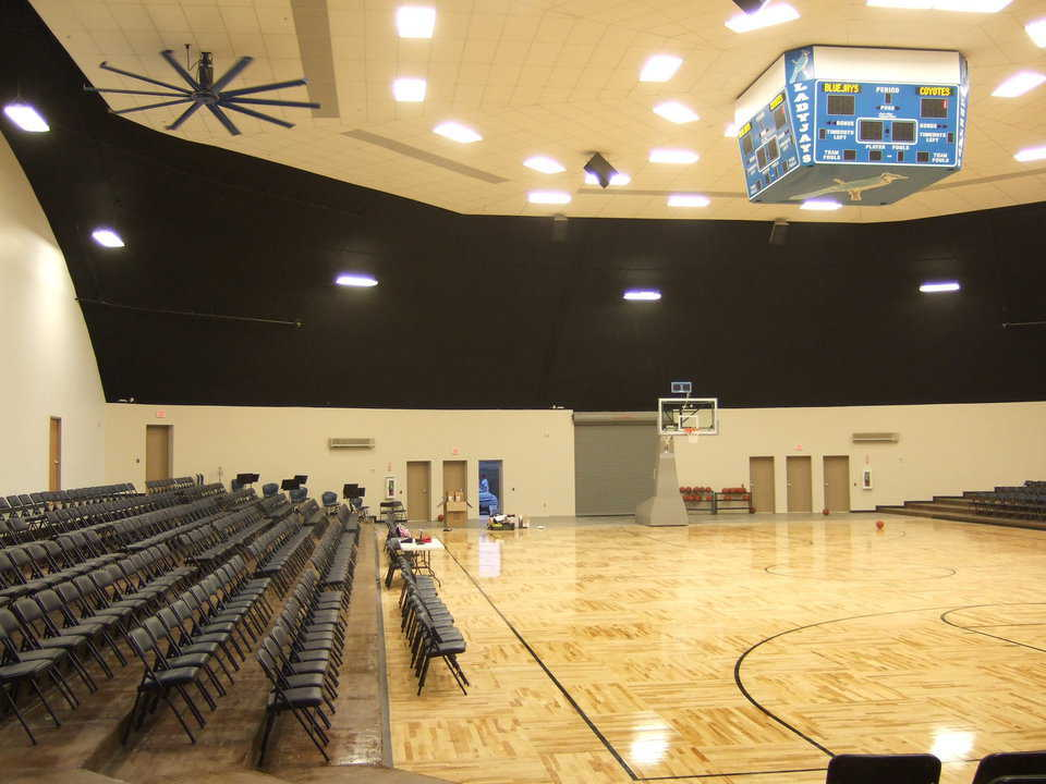 Super Features! — They include a regulation floor, suspended score board, ceiling fans and good lighting. In January 2010, permanent, comfortable seats will replace the temporary folding chairs.