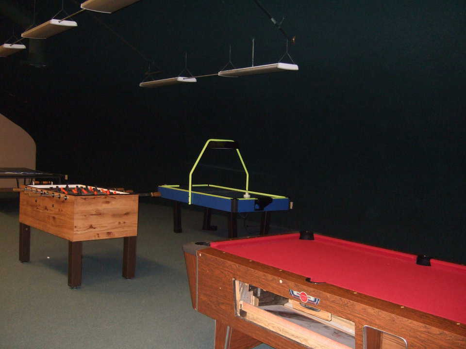 Mezzanine — Various game tables keep teenagers and young adults busy.