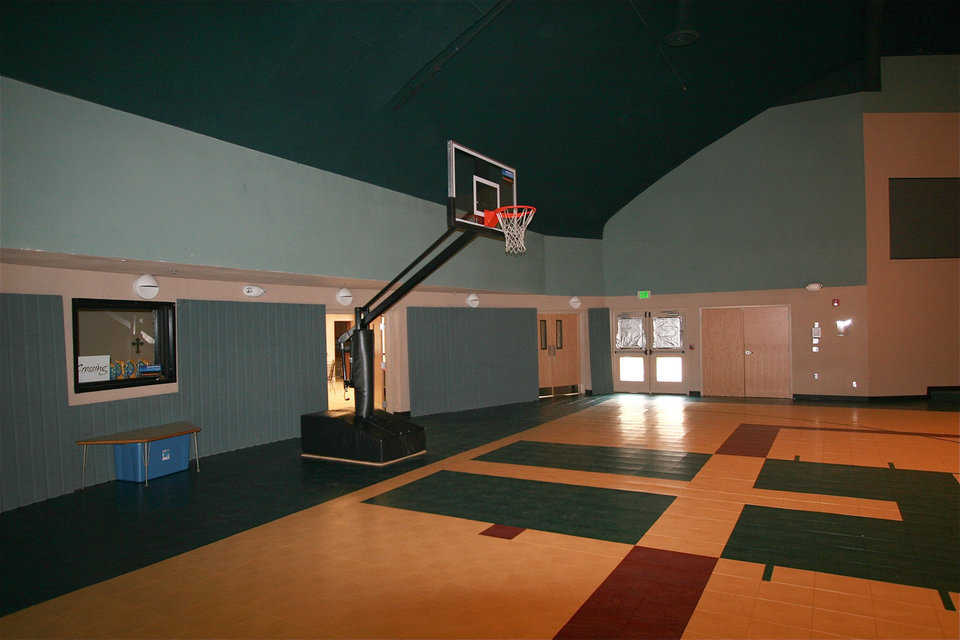 Safety first! — The basketball court features versapanel walls that protect players, help with acoustics and that can be used as room dividers.