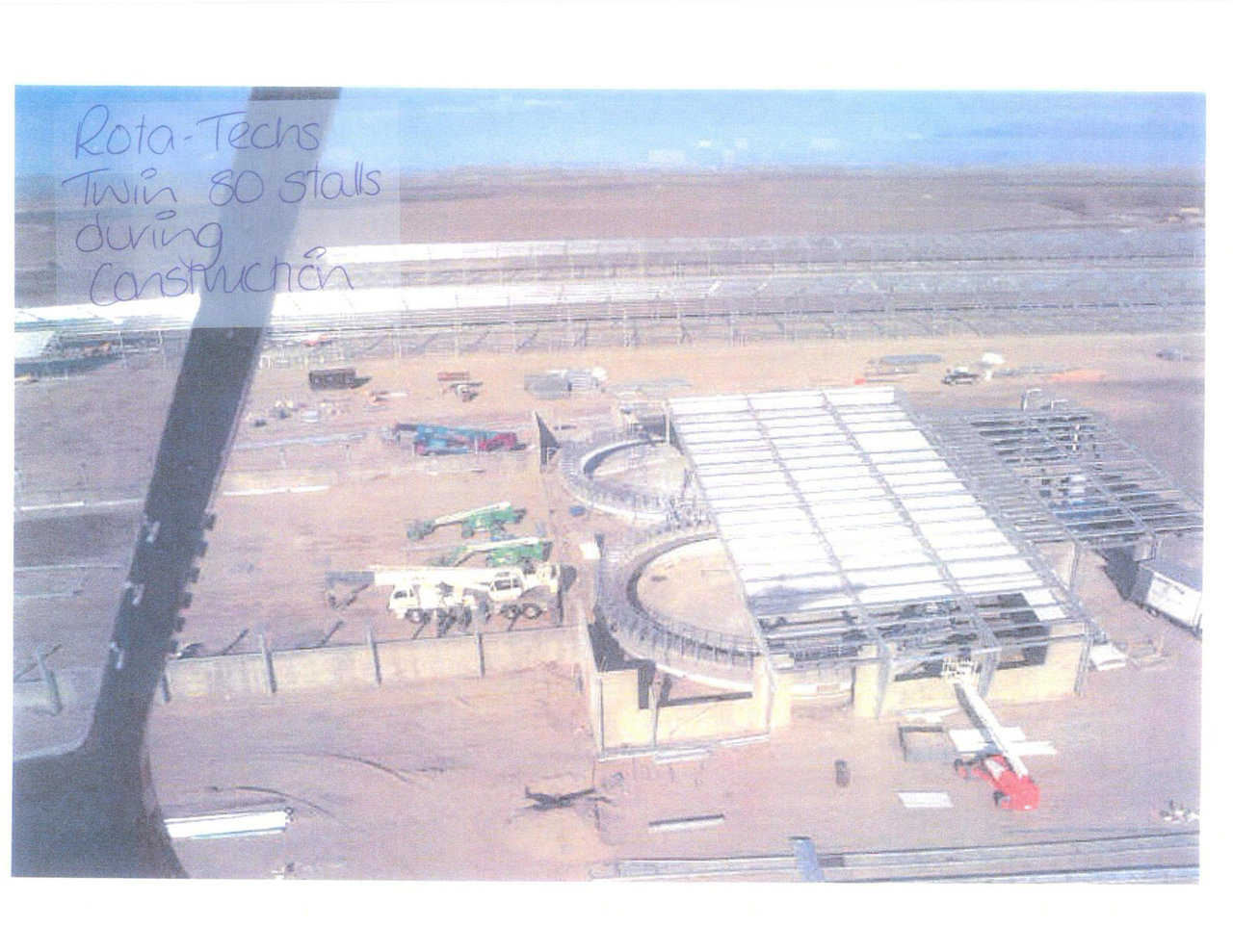 Aerial view underconstruction — It is impossible to efficiently cover a round structure with a square building.