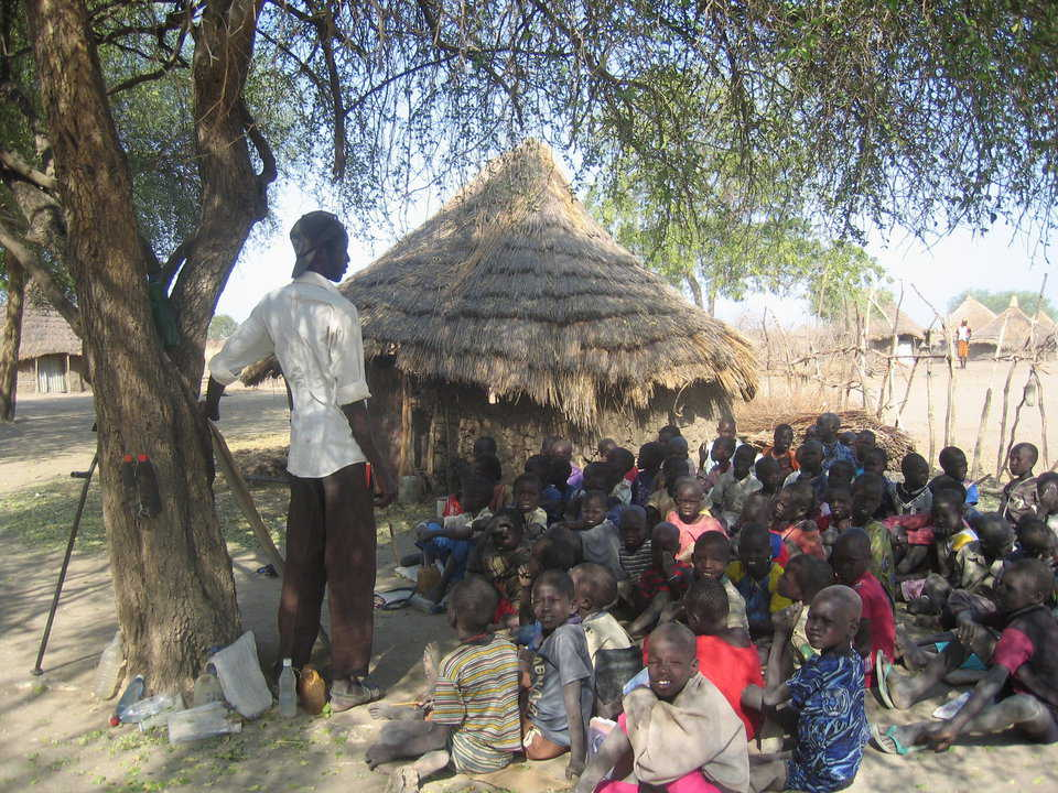 A Southern Sudan school — Typical primary school in Southern Sudan. Inside the mud huts children sit on dirt mounds and are not protected from termites and harsh weather.