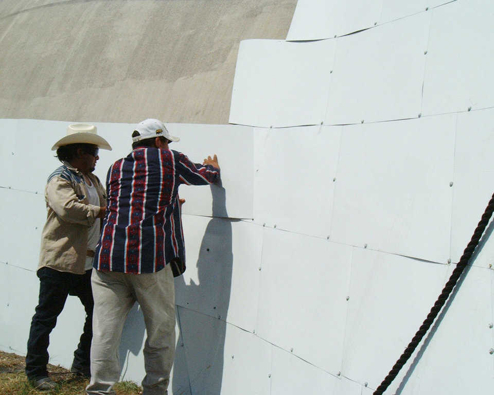 Metal Cladding — Application of metal cladding on Bruco in Italy, Texas. Metal Cladding is metal plates similar to shingles fastened to each other and the dome with mechanical fasteners. Metal cladding is especially useful for the dome built without the Airform or to cover a dome with Airform difficulties.