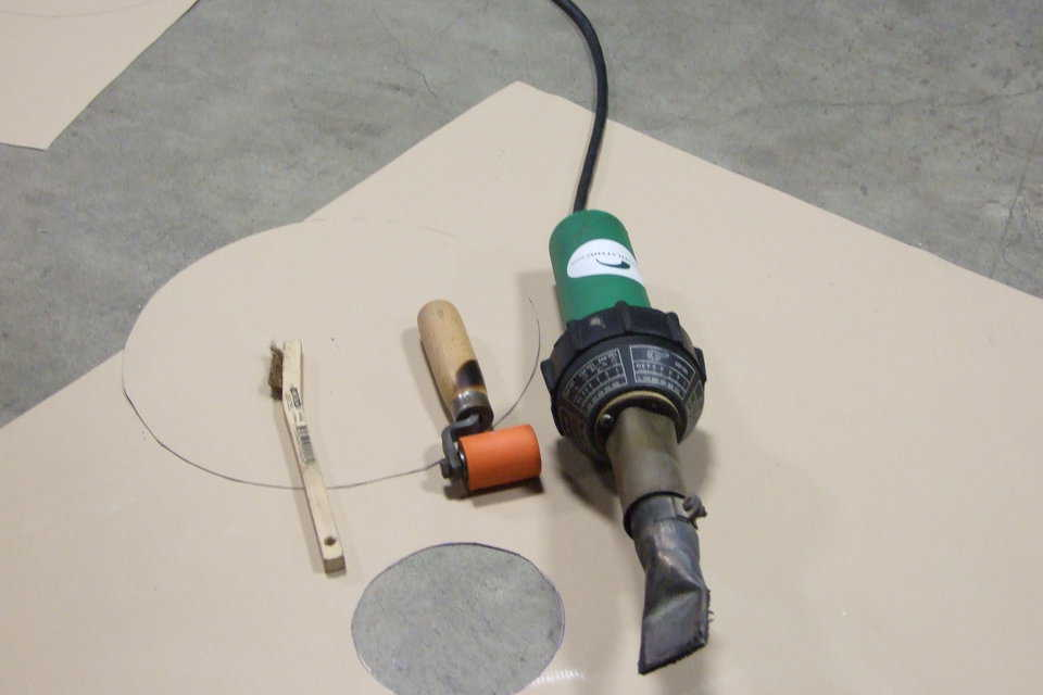 Welding Tools — Here are the tools needed to install a patch using a heat gun. From left to right, we have the industrial heat gun, the hand roller, and a wire brush for cleaning the gun tip.