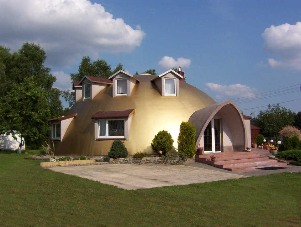 Pregowski Monolithic Dome Home — In 2000, Monolithic Construction of Poland built this two-story Monolithic Dome dream home that has a 50-foot diameter and a living area with 2500 square feet. In 2007, Jan cleaned the Airform and gave it a beautiful, new look with products available in Poland.